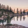 Alpenglow from camp at Wing Lake.- Black Peak: Northeast Ridge