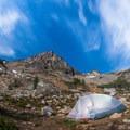 Full moon lighting camp and Black Peak.- Black Peak: Northeast Ridge