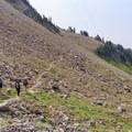 Crossing the scree field of the Johnson Peak cirque, above Lilly Basin, nearing the Angry Mountain Trail junction.- Goat Rocks Thru-hike
