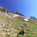 Crossing a scree field in the south Johnson Peak cirque, nearing the Hawkeye Point Trail junction and spur.- Goat Rocks Thru-hike