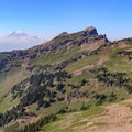 View of Mount Rainier as smoke clears above Johnson Peak and the southern meadow cirque below.- Goat Rocks Thru-hike