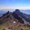 Hikers descend the Hawkeye Point Trail to the saddle junction with the Lilly Basin Trail.- Goat Rocks Thru-hike
