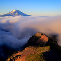 Long exposure revealing the spindrift over Goat Ridge with Mount Adams above.- Goat Rocks Thru-hike