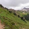 The trail continues northeast after rounding the Hawkeye Point spur toward Goat Lake.- Goat Rocks Thru-hike
