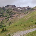 Looking back at the Goat Lake basin as the Lilly Basin Trail continues south toward Snowgrass Flat.- Goat Rocks Thru-hike