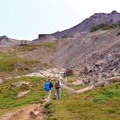 Hikers making their way along the PCT to the summit of Old Snowy Mountain (above).- Goat Rocks Thru-hike