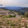 Mount Adams and Mount St. Helens on the horizon above the PCT on descent from Old Snowy Mountain.- Goat Rocks Thru-hike