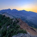 The rampart cliff above Cispus Pass on a smoke-filled morning.- Goat Rocks Thru-hike