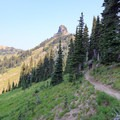Looking back north on the PCT as it descends a spur out of the Goat Rocks alpine toward Sheep Lake.- Goat Rocks Thru-hike
