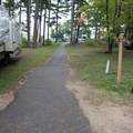 Path to the pedestrian walkway accessing the beach.- Keith J. Charters Traverse City State Park Campground