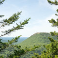 Looking at Schoodic Mountain from Black Mountain Cliffs. The valley below connects the beach and the trailhead.- Schoodic Beach via Black Mountain Cliffs Trail