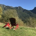 As you walk down a bit further across the paved roadways you will reach a pavilion with these two viewpoint chairs. The Fisher's Trail, which winds scenically along the river, is to the left (south).- Needle Peak