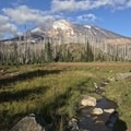 Crossing a meadow beneath Mount Adams.- Mount Adams Circumambulation