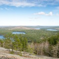 McCabe Mountain in the distance with Little Long Pond and Tilden Pond below.- Tunk Mountain