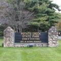 Entrance sign for Potato Creek State Park.- Potato Creek State Park