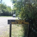 Trailhead signage for Friends' Wetland Trail.- Potato Creek State Park