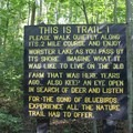 Trail sign reminding hikers to enjoy the serenity of the trail.- Potato Creek State Park