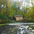 View of the historic Spring House along Trail 4.- Potato Creek State Park