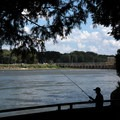 A fisherman casts a line into the Illinois River.  - Starved Rock State Park
