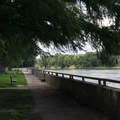 The river walkway has benches and shade trees. - Starved Rock State Park