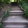 A staircase leads from a trail to the river walkway. - Starved Rock State Park