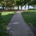 A cement pathway leads to the river walkway. - Starved Rock State Park