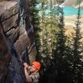 Going for that hold. - Lake Louise: Back of the Lake