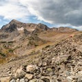 Rocky trail toward Arapaho Pass.- Lake Dorothy