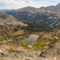 View of beautiful Caribou Lake from the top of Arapaho Pass.- Lake Dorothy