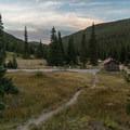 Pit toilet at the trailhead.- Neva Backcountry Zone