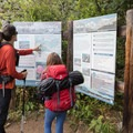Checking out the trail map.- Neva Backcountry Zone