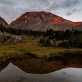 Camping for a couple of nights provides sufficient time to admire sunsets like this one.- Neva Backcountry Zone