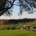 Picnic table at one turnaround point offers beautiful views and a quiet place. - Ganondagan State Historic Site