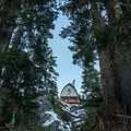 The first view of the hut through the trees. - BCMC Watersprite Hut