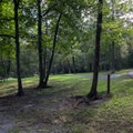 The park has a wooded campground.- Shawnee State Park