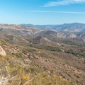 The view begins to open up as the trail rapidly gains elevation.- Lawson Peak