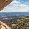An interesting rock formation framing Barrett Lake.- Lawson Peak