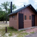 Restroom with a group site directly behind it.- Bessey Recreation Complex + Campground