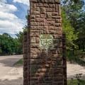 A U.S. Forest Service symbol adorns the gateway.- Bessey Recreation Complex + Campground