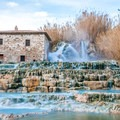 The water looks very blue in the travertine pools.- Cascate del Mulino in Saturnia