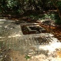 Lingams on the river bed floor.- Kbal Spean