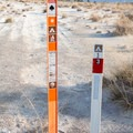 Campground marker sign. If the site isn't wet, you should camp within 5 feet of the sign. - White Sands National Monument Dispersed Campsites