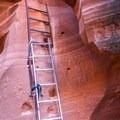 An old rickety ladder used to climb up a sheer drop. These ladders have since been upgraded by the tour company.- Waterholes Canyon