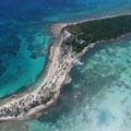 Photographer John Romero's photo of Half Moon Caye from the air.- Belize Barrier Reef System