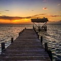 Sunset at Glovers Reef Atoll. Photo by John Romero.- Belize Barrier Reef System