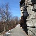Loop Road passing beneath granite cliffs- Shawangunk Ridge Trail: Sam's Point Section