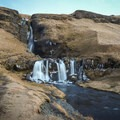The upper falls are about 44 meters tall, while the lower are about 8.5 meters in height.- Gluggafoss (Merkjárfoss) Waterfall