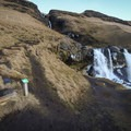 A marked path climbs to the base of the upper falls.- Gluggafoss (Merkjárfoss) Waterfall