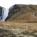 Skógafoss falls about 60 meters (197 feet) down a sheer drop in southern Iceland.- Skógafoss Waterfall