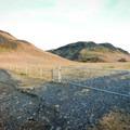 Before hitting the farm gate, veer left on the gravel path.- Kvernufoss (Sigurfoss) Waterfall